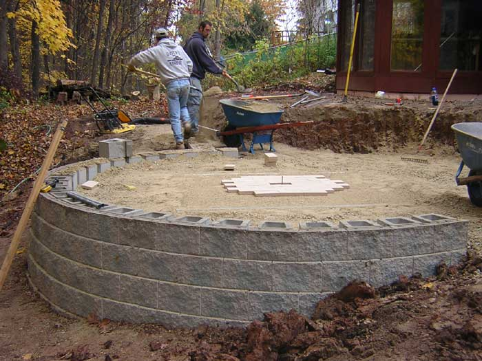 mid-construction of amphitheater paver patio