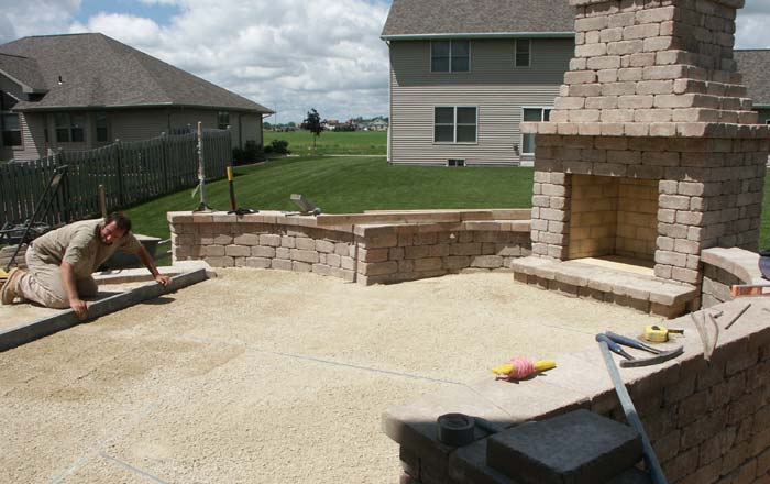 during construction of outdoor fireplace and patio