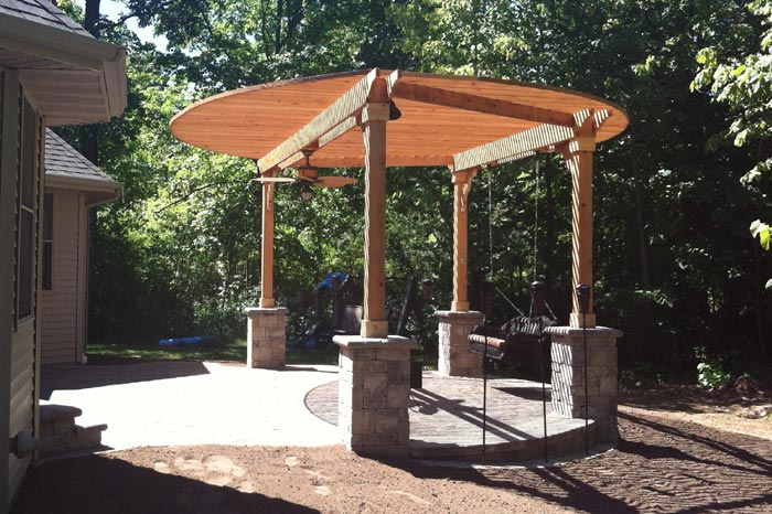 round arbor canopy over brick pavers