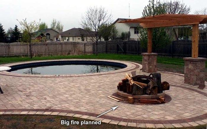brick patio around pool, arbor, swing and fire pit
