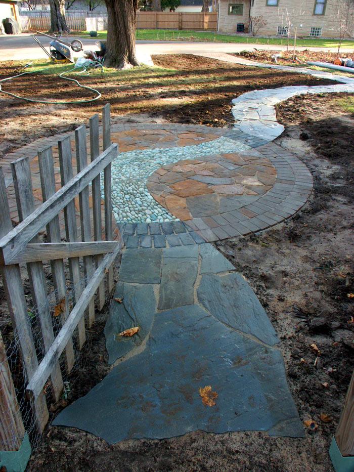 Pebbles and Flagstone Mosaic Patio