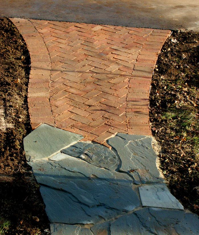 Transition from brick pattern to freeform irregular bluestone