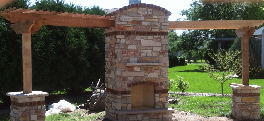 Brick and stone veneer fireplace